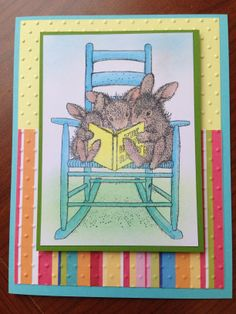 This is a HappyHoppers Image from Stampendous called Reading Rabbits. It is colored with Copics and them the grass and sky are chalked.