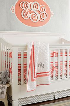 Coral + Gray nursery - loving the chevron bedskirt and that gorgeous monogram above the crib! http://rstyle.me/n/f28vmn2bn