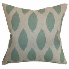 "Cotton pillow with an ikat motif. Made in the USA.    Product: PillowConstruction Material: Cotton cover and 95/5 down fillColor: Light blue and linenFeatures:  Insert includedHidden zipper closureMade in the USA Dimensions: 18"" x 18""Cleaning and Care: Spot clean"