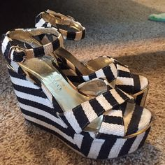 Very Volatile Black and Cream Wedges Used, good condition. Size 7. Black and cream stripes. Woven material. Gold hardware. Shoes Wedges