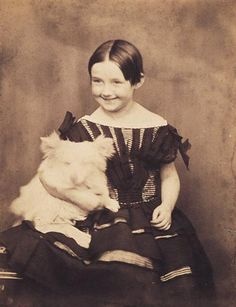 George Eastman House  Descriptive Title: Girl with dog  ca. 1853  Salted paper print  Sweet smile!