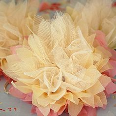 Enchanting flowers made from tissue paper and tulle.