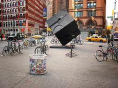 "Astor Place, NYC | Next to the Astor Place subway station is a black steel cube called ""Alamo"", a meeting point for students and skaters"
