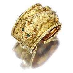 An 18k gold and emerald cuff bracelet, David Webb