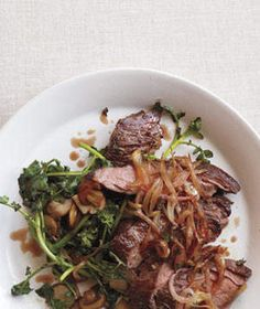 Skirt Steak With Shallots and Sautéed Watercress | Craving meat? Indulge in one of these simple yet tasty steak recipes—sides included.