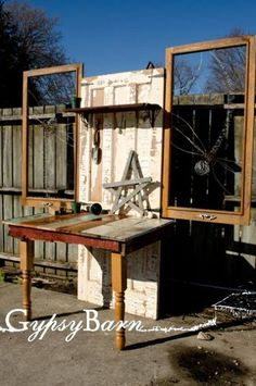Potting table from - Old door, fence boards, table legs, two old screen window frames, left over electric fence wire (the large dragonflies) and two drawer pulls to hang your towels and tools on