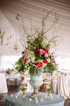 Erika- I know we discussed shorter centerpieces, butI LOVE this style for card tables, etc. Not in these colors. I like the height with the short table arrangements on the table. Maybe we should add a couple of dinner tables with some height?