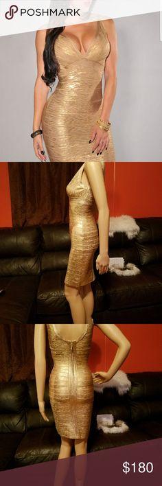 Metallic dress Shine on this beautiful Crisscross metallic bandage dress MODAYABRI Dresses