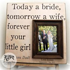 A wedding photo book or custom frame make a great present for you parents.