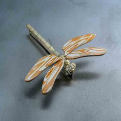Mokume Gane Dragonfly brooch in 14k yellow gold with diamonds accents by DFJD.