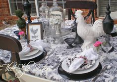 Black and white toile tablescape with a touch of pink...perfect for Valentine's day