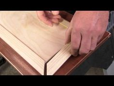 If your cabinets are really plain or outdated, considering adding some decorative raised panels before you paint them. Get started by cutting plywood into smaller panels that will fit on the panel fronts. They will need to be big enough to cover existing grooves. Next apply a adhesive to the panels and center them on the doors. Miter cut molding...