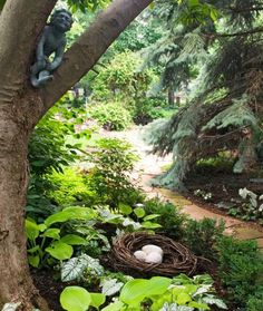 Add whimsical elements like an imp in the crook of a tree, or a nest of plastic dinosaur eggs. Click for more inspirations! http://www.midwestliving.com/garden/ideas/garden-art-anyone-can-create/page/7/0