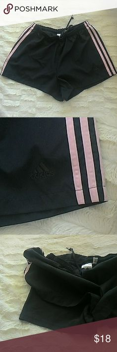 NWOT Adidas Shorts Super cute shorts with soft inner briefs. Black body with three pink stripes. Size M. Elasticized waist with drawstring. 100% polyester. I never wore them or washed them. Has Adidas logo in black on left lower leg. Climalite. Adidas Shorts