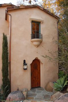 loewen windows Mediterranean Exterior Image Ideas Santa Barbara arched door clay tile roof copper rain gutters juliet balcony loewen windows mediterranean style lantern radius door santa barbara style Spanish Colonial stucco tile roof wooden door