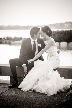 Wedding couple on the pond at Inn at Laurel Point - Photograph by Leanne Pedersen