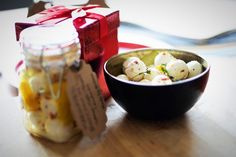 This gift from the kitchen is a great high protein, low carb option for those people in your life who don't have a sweet tooth. Marinated bocconcini is a unique and unexpected gift from the kitchen and the perfect edible hostess gift. Head to my website for more info!   Makes 1 250ml jars  200g marinated bocconcini balls (16 pieces) 2 1/2″ wide strips lemon zest 2 small springs of thyme 1 tsp white wine vinegar pinch chili flakes 1/4 cup olive oil 1/4 cup canola oil White Wine Vinegar, Canola Oil, Hostess Gifts, High Protein, Sweet Tooth, Appetizers, Low Carb, Snacks, Breakfast