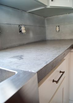 DIY Concrete Counters Poured over Laminate - how we poured concrete over our laminate counters so we could install our stainless steel apron front sink. Concrete Countertops Over Laminate, Concrete Kitchen, Countertop Materials, Laminate Countertops, Kitchen Countertops, Kitchen Cabinets, Stainless Steel Apron Sink, Stainless Steel Counters, Oak Bedroom Furniture