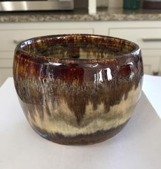 Jocelyn Bowie. Oatmeal (3 coats brushed) with ancient jasper on the rim and oil spot (3 coats brushed) around the base.