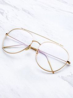 Gafas de sol doble puente con marco dorado y lentes transparente