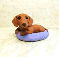 Dachshund in dog bed polymer clayn Doxie sculpture by Raquel
