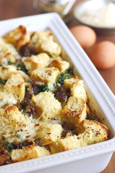MAKE-AHEAD Cheese Strata with Sausage, Kale and Caramelized Onions