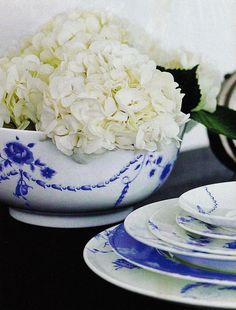 Blue and white china with white hydrangeas - from At Home with Wedgewood: The Art of the Table, by Tricia Foley