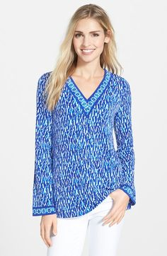 A relaxed tunic cut from matte jersey sports a summery print in a choice of vibrant colors accented with a contrasting tile-print border around the V-neckline and cuffs. MICHAEL Michael Kors 'Riviera - Porcelain Border' V-Neck Tunic save -55% today