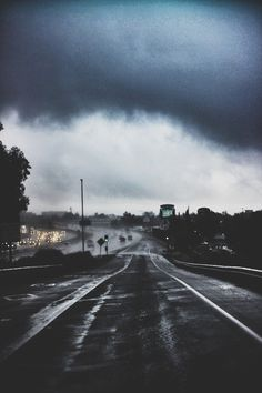 Dark skies cars dark rain storm sky lights nature clouds street grey
