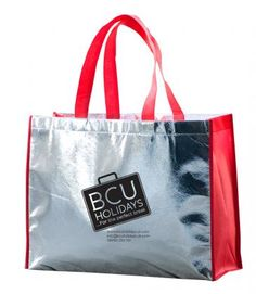 Metallic Beach Bag  Put some bling into your promotions with the Metallic Beach Bag. Large silver bag with brightly coloured trim and handles. Made from non-woven laminated material.