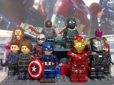 Prepping for the showcase. Are you #teamcap or #teamironman ? #Lego #custom #minifigure #showcase #civilwar #captainamerica #ironman #teamcap #or #teamironman #blackpanther #spiderman #blackwidow #scarletwitch #hawkeye #falcon #bucky #antman #warmachine #vision by daring_customs