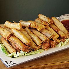 Fan-Favorite Game-Day Dishes | Shanghai Spring Rolls with Sweet Chili Sauce | SouthernLiving.com