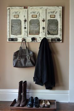 This unique home organizer has three chalkboards that are actually vintage roof slates.  Other vintage hardware is used for hanging coats and keys.  From Second Chance Art & Accessories®  $1750