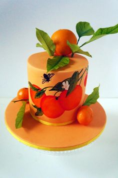 Cake Title was actually made up by the Cake Recipients. It was for a Wedding Anniversary and the theme is close to both parts as they have Bees and grow Oranges back in Jamaica. I hand painted the Oranges on the fondant. The little satsumas are...