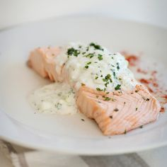 Gently simmering salmon in a flavorful white-wine broth is a classic cooking method that gives the fish a delicious flavor and a delicate texture. Ser...