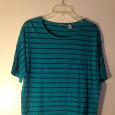 Chico's short sleeve striped top Super cute Chico's striped shirt with tie at the side. Can be dressed up or down! This is a Chico's size 1, so, that's equivalent to a size M or 10-12 in some other brands. Teal with blue stripes. Very soft and comfortable! Chico's Tops