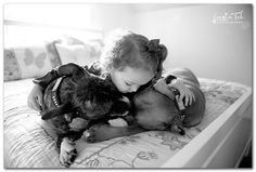 "THESE are Pit Bulls. They're amazing family dogs, WONDERFUL with kids of all ages. It drives me nuts to see shelters recommend them to homes with ""older children"" because of a Pitties' ""size"". They seem to ""know"" when to be gentle!"