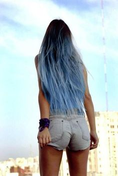 Long brown hair w/ light blue dyed ends.