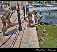 Kids jumping in River Statue by Chong Fah Cheong, Raffles Place, Singapore posted on Flickr - Photo Sharing! by Mukul Banerjee