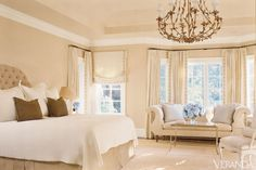 Uncluttered style creates a background of serenity in this master bedroom. Glant linen-cotton for headboard and bedskirt. Nancy Corzine silk-cotton on pillows. Rose Cumming silk with Samuel & Sons Banding at windows. Vaughan lamp.  INTERIOR DESIGN BY SUE BURGESS   - Veranda.com