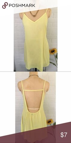 Canary yellow slip dress This canary yellow dress is breezy and perfect for the spring and summer. The neckline and open back is a great detail to make the dress a bit more unique *necklace not included* Dresses Mini
