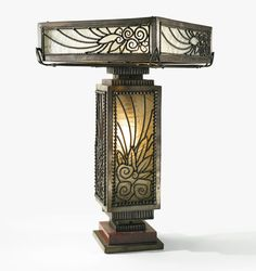 Attributed to Paul Kiss TABLE LAMP patinated wrought-iron, marble and frosted glass 16 1/8 x 9 1/2 x 9 1/2 in. (41 x 24.1 x 24.1 cm) circa 1920.