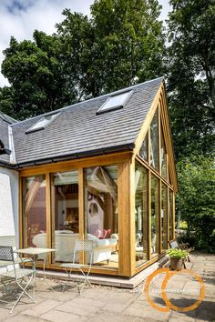 Oak frame family home situated on the shores of Loch Lintrathen. A vaulted ceiling and glazed gable end bring in unfiltered views of the loch and woodland. House Facades, Facade House, Cottage Extension, Green Homes, Round House, Sun Room, Open Plan Living, Gazebo, Extensions