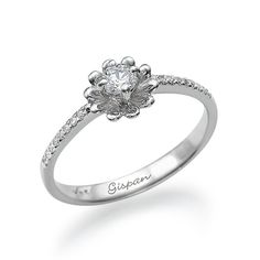 White gold ring 14k in the shape of flower.Engagement ring 14k White Gold Flower Shape - Gispan diamonds & jewelry design