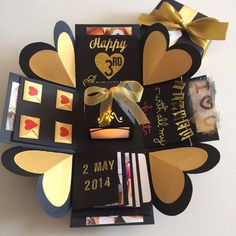 """Buy Explosion Box With Lighthouse, 4 Waterfall In Black & Gold in Singapore,Singapore. ----------- Info ------------- Size: 4x4""""  Explosion box card with  - 2 layers - 4 customized photos at the base layer  - a 3D lighthouse in the center with bat Chat to Buy"""