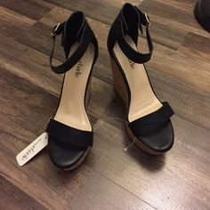 Black with a tan base wedges Awesome, brand new, black with a tan base wedge Charming Charlie Shoes Wedges