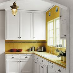 I like this yellow and white kitchen. Simple and cute.