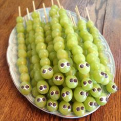 My try at grape caterpillars for my son's kindergarten class snack! The eyes are mini chocolate chips set in frosting. ItsAllAboutAmy #healthysnacksforschool