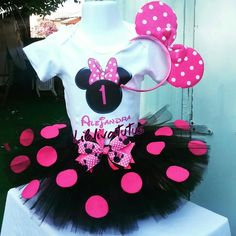 Handmade Minnie mouse tutu set consist of polka dots tutu, top and Minnie mouse ears. This beautiful tutu is made out of black tulle and pink polka dots, onesie or muscle shirt has a heat transfer Minnie mouse head with your little ones name and number. Please send write on the notes to seller or message with name and number.  Want to upgrade to a bow instead of Minnie Mouse ears, you can for an additional $3dlls more, if you want both Minnie Mouse ears and Hair bow the price is $5dlls…
