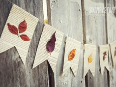 Adhere pressed leaves to pennant-shaped pages of an old book to create this gorgeous display.